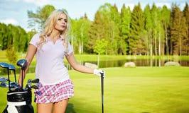 Girl play golf Stock Image