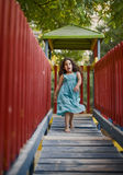 Girl in play ground. Girl runing on a wooden bridge in a playground Stock Photography