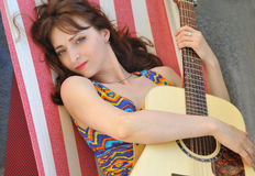 Girl play guitar Stock Images
