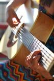 Girl play guitar Stock Image