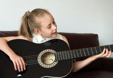 Girl play guitar. Stock Photo