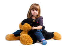 Girl play with her plush dog Stock Image