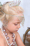 Girl play with jewellery Royalty Free Stock Photo