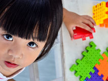 Girl play and looking Royalty Free Stock Images