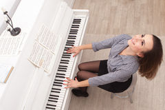Girl play piano Stock Image
