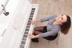 Girl play piano Stock Image