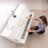Girl play piano Stock Photography