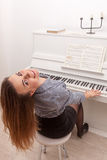 Girl play piano Royalty Free Stock Photography