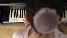 Girl Play Piano stock footage