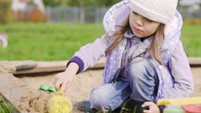 Girl play in the sandbox stock footage