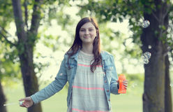 Girl play with soap-bubbles in forest Stock Photos