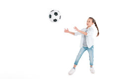 Girl play with soccer ball. Little girl with soccer ball isolated on white, children sport concept Stock Image