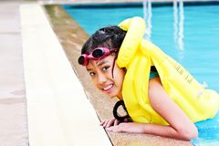 Girl play at the swimming pool Stock Images