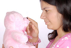 Girl play with teddy Royalty Free Stock Photos