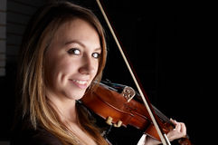 Girl play on violin. Look in center royalty free stock photo