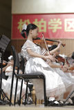 A girl play the violin carefully Royalty Free Stock Images
