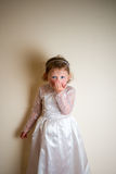 Girl (4) in play wedding dress blowing kiss Stock Image
