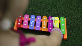 Girl play on xylophone Royalty Free Stock Image