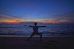 Girl play yoga on the beach. Exercise Royalty Free Stock Photos
