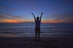 Girl play yoga on the beach. Exercise Stock Photography