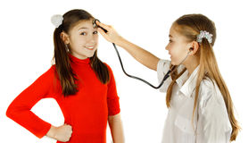 Girl played be a doctor Stock Photo