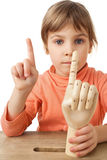 Girl is played by wooden hand of manikin isolated Stock Photos