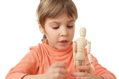 Girl is played by wooden little manikin isolated Stock Image