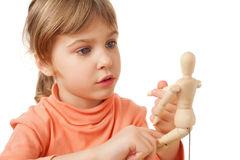 Girl is played by wooden little manikin isolated Royalty Free Stock Photo