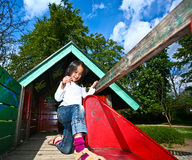 Girl on a playfield in Denmark Royalty Free Stock Image