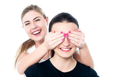 Girl in playful mood teasing her friend Royalty Free Stock Image