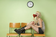 Girl Playfully Eats Chocolate Heart Royalty Free Stock Photo