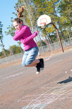 Girl on playground Stock Images