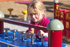 Girl at playground. A little girl having a great time at the playground Royalty Free Stock Photos