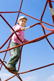Girl at playground. Happy young girl playing at playground Royalty Free Stock Photos