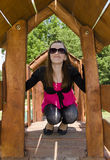 Girl on playground Stock Photo