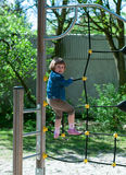 Girl on the playground. 5 year old girl moving up on a rope ladder,Germany,Graben-Neudorf Royalty Free Stock Image