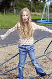 Girl in playground Stock Photo