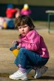 Girl on playground Stock Photo