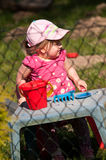 Girl in playground Stock Image