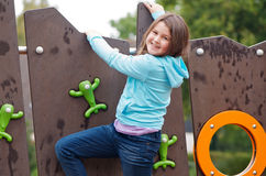 Girl at playground Stock Photos