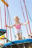 Girl at playground Stock Photos
