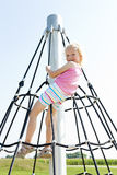 Girl at playground Stock Photography