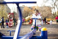 Girl at the playground. Little girl at the playground Royalty Free Stock Images