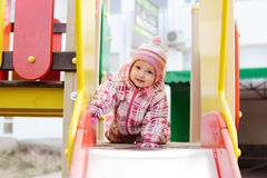Girl on the playground Stock Images