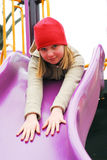 Girl on playground Royalty Free Stock Images
