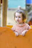 Girl on the playground royalty free stock image