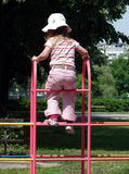 Girl at playground. Girl playing at playground Stock Photo