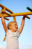 Girl on playground Stock Photos