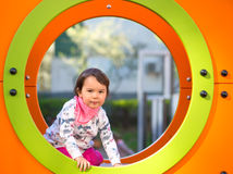 Girl on the playground being happy Stock Photo