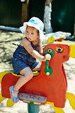 Girl on the playground. Cute and fashion girl on the playground Royalty Free Stock Image